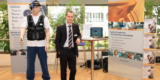 Markus Sippl, Product Manager TRAVIS, presents the TRAVIS tools Callisto (left) and Mentor (right) at the Maschinenbauforum 2011 in Pforzheim, Germany