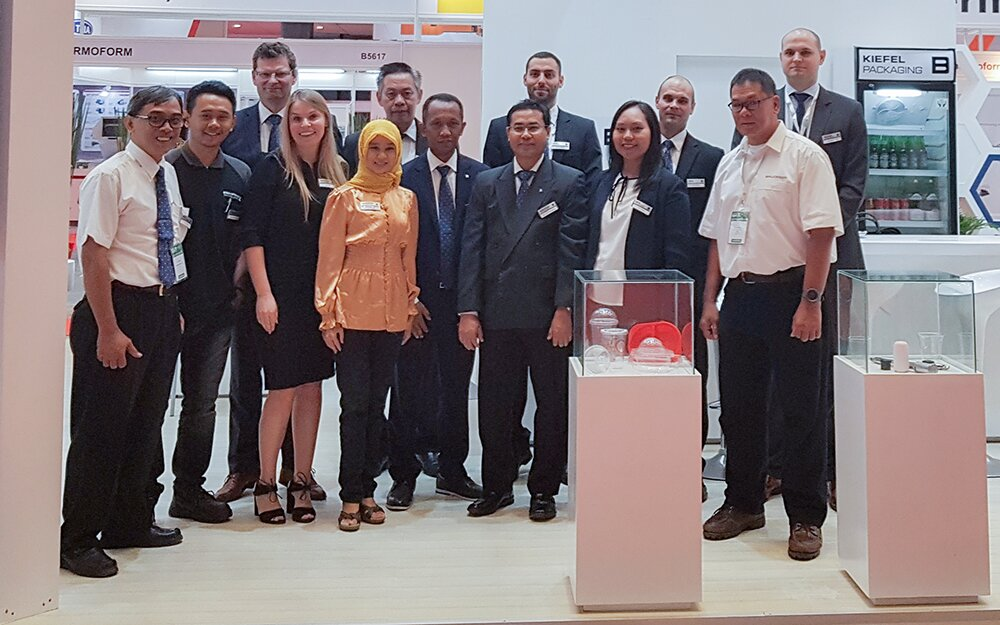 Brückner Group booth staff says thanks to all visitors