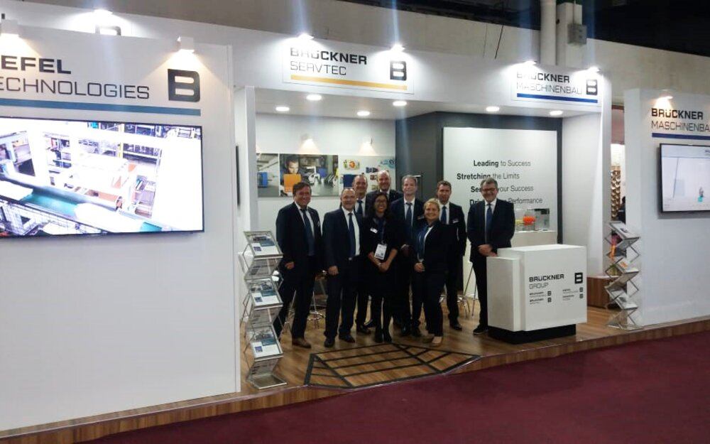 Staff at joint Brückner Group booth