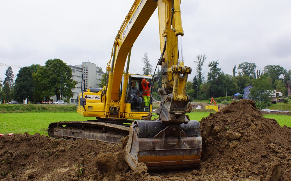Excavatorin the green